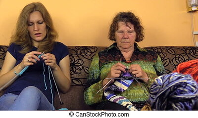 knitters and wool balls - Senior grandmother and young woman...