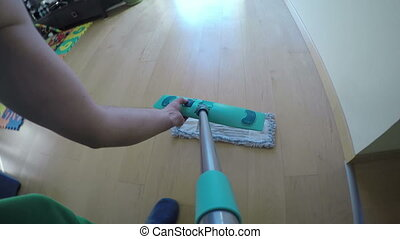man wash floor with broom - Man hands put wet mop on broom...
