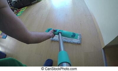 man wash floor with broom - Man hands put wet mop on broom...
