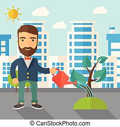 Man watering the plant - A man watering the growing plant as...
