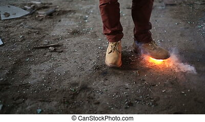Yellow boots and a fire under them - Under yellow shoes fire...