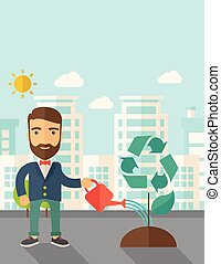 Man watering a tree. - A man watering the green recycle tree...