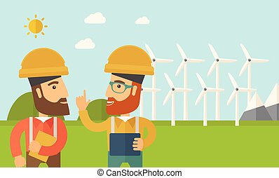 Two workers talking infront of windmills. - A two workers...