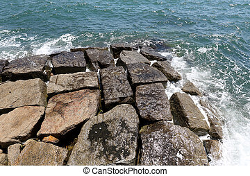 Stone breakwater seawall for protection of coast