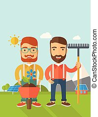 Two men with wheelbarrow and rake. - A two smiling gardener...