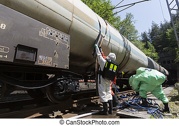 Toxic chemicals acids emergency team near tank - A team...