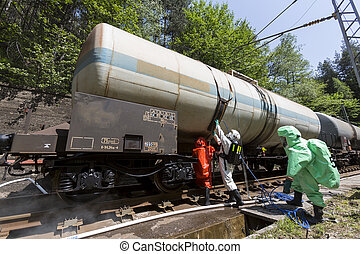 Toxic chemicals acids emergency team near train - A team...