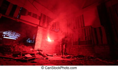 burning red signal flares in hand