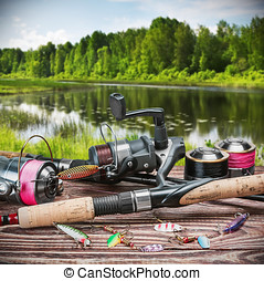 fishing tackle and accessories on the table against the...