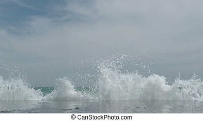 Waves Breaking on the Breakwater , a Wall of Water Rises and...