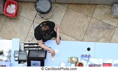 Female cashier working in cafe - Anonymous female cashier...