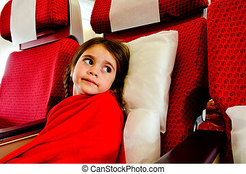 Little girl in a plane scared to fly - flying phobia -...