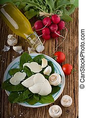 Twisted slovak cheese on plate with vegetable around