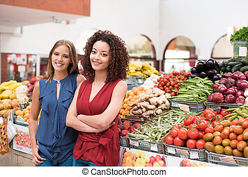 Women at greengrocer - Business women presenting their...