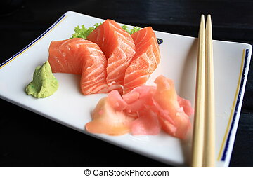 salmon - fresh salmon on a plate with wasabi and chopsticks