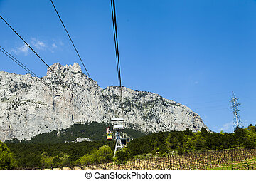 Ropeway on the high mountain in the sunny day