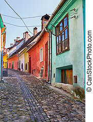 Picturesque alley in Sighisoara - Colourful houses on a...