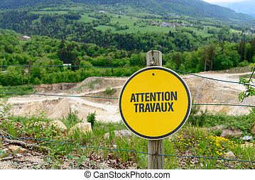 french yellow sign indicating a construction site