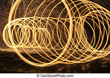 steel wool - rings of fire and bright sparks light up the...