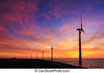 Vibrant sunset turbines - Beautiful sunset at the dike with...