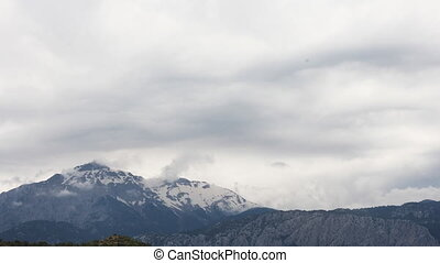 Panoramic view of snow mountains before storm Turkey,...