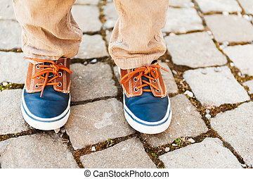 Fashion sneakers on kid's feet