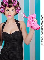 glamorous housewife with rollers and cleaning products