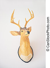 Wooden deer head on the wall, decor