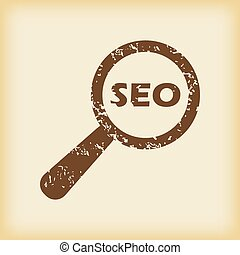 Grungy SEO search icon - Grungy brown icon with text SEO...