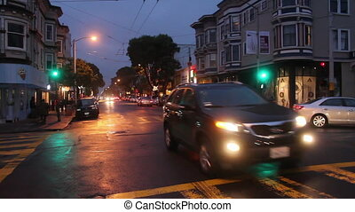 Haight and Ashbury Intersection - Cars pass through the...