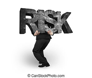 Man carrying risk concrete word isolated on white - Man...
