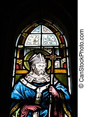 saint on glasswork - coloured glasswork painted a saint with...
