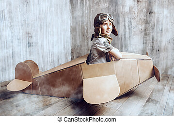 aviator - Little dreamer boy playing with a cardboard...