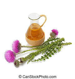 thistle oil and milk thistle flower isolated on white...