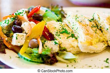 tramezzini - a tramezzini and salad on a plate
