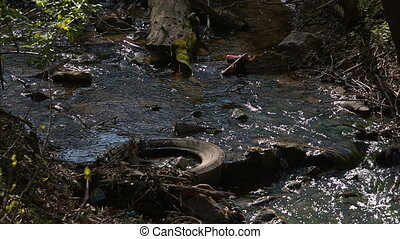 Water pollution in river with trash - Large amount of trash...