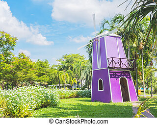 Colorful decorative windmill in the public park at Suanluang...
