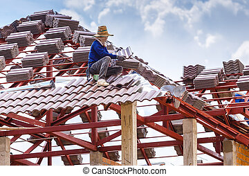 roof under construction with stacks of roof tiles for home...