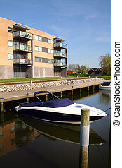 appartments by canal or river with boats. flats in denmark