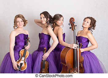 musical quartet in evening dresses with strings