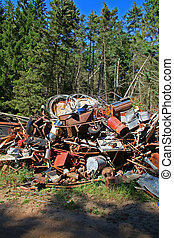 scrap dump pollution - rubbish dump pollution. forest with...