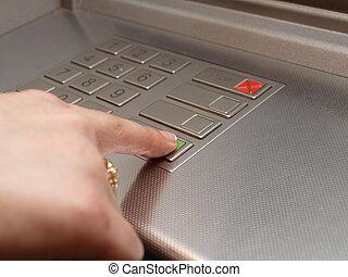 ATM dials - someone pressing OK button
