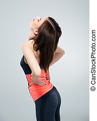 Sports woman having back pain
