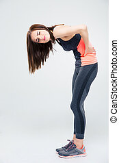 Sporty woman having back pain
