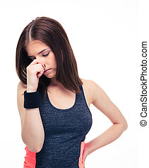 Fitness woman covering her nose with hand isolated on a...