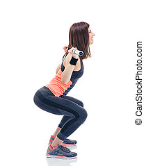 Fitness woman doing squatting with barbell - Side view...