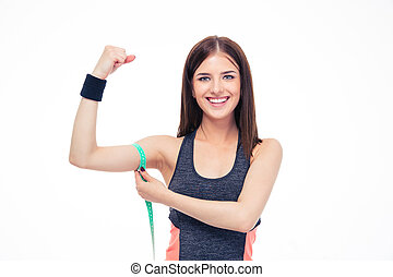 Woman measuring her biceps with measurement tape - Happy...