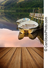 Rowing boats moored at jetty on Llyn Nantlle in Snowdonia...