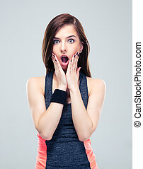 Shocked fitness woman looking at camera - Shocked fitness...