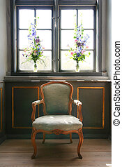 armchair antique manor house - antique armchair in front of...